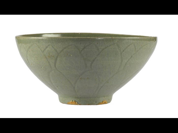 Teabowl of stoneware with incised decoration on exterior of lotus petals, and celadon glaze: Korea, 13th century.