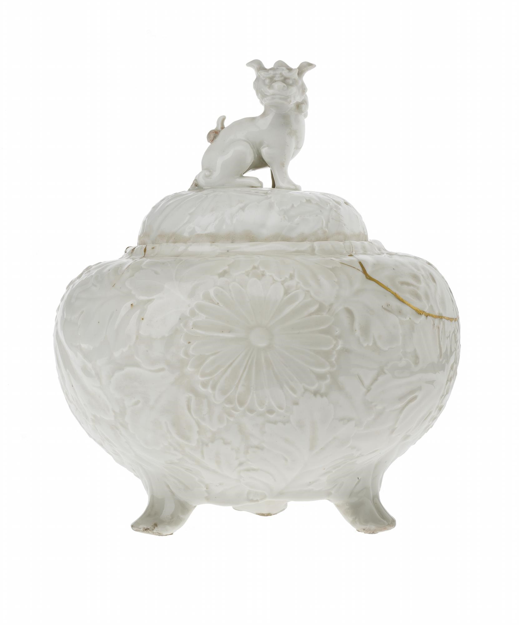 Jar and cover of porcelain with white glaze, bulbous and tripod, moulded with chrysanthemums in relief, lion-dog knop on cover, broken and repaired with gold lacquer: Korea, 18th century.