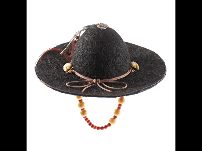 Royal courier's hat (jeonrip) made of cow-hair with a chin-band of beads, a peacock feather and red cord: Korea.