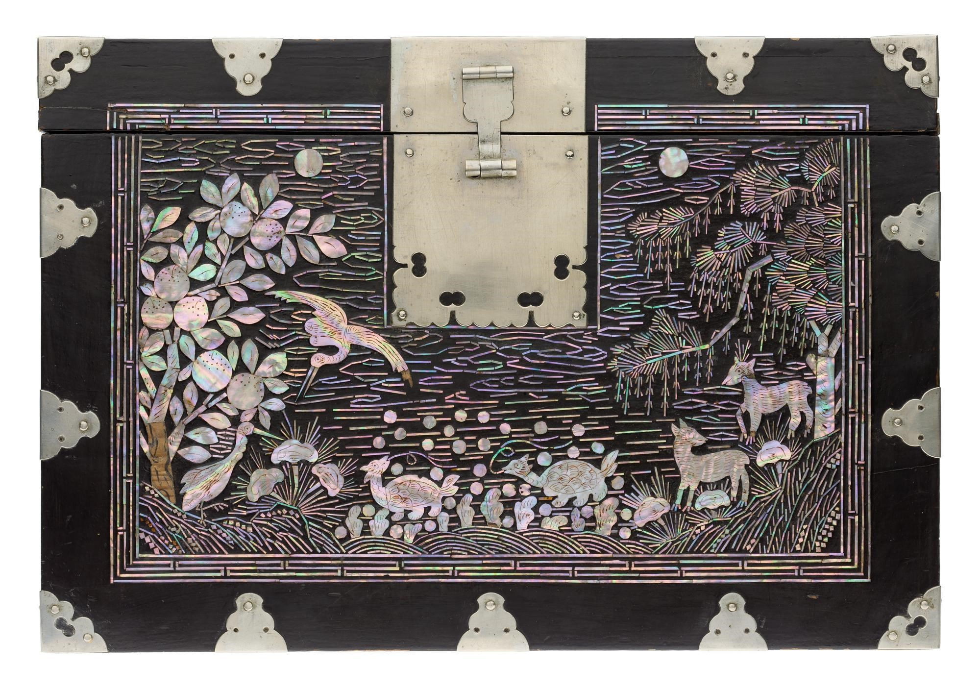 Lidded document box (soryu ham) of black lacquered wood inlaid with mother-of-pearl, with metal mounts and handles: Korea, Joseon Dynasty, late 19th century.