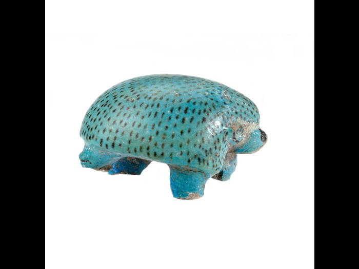 Figurine of a hedghog in a marching pose, made of blue faience with the quills indicated by brown flecks: Ancient Egyptian, Middle Kingdom.