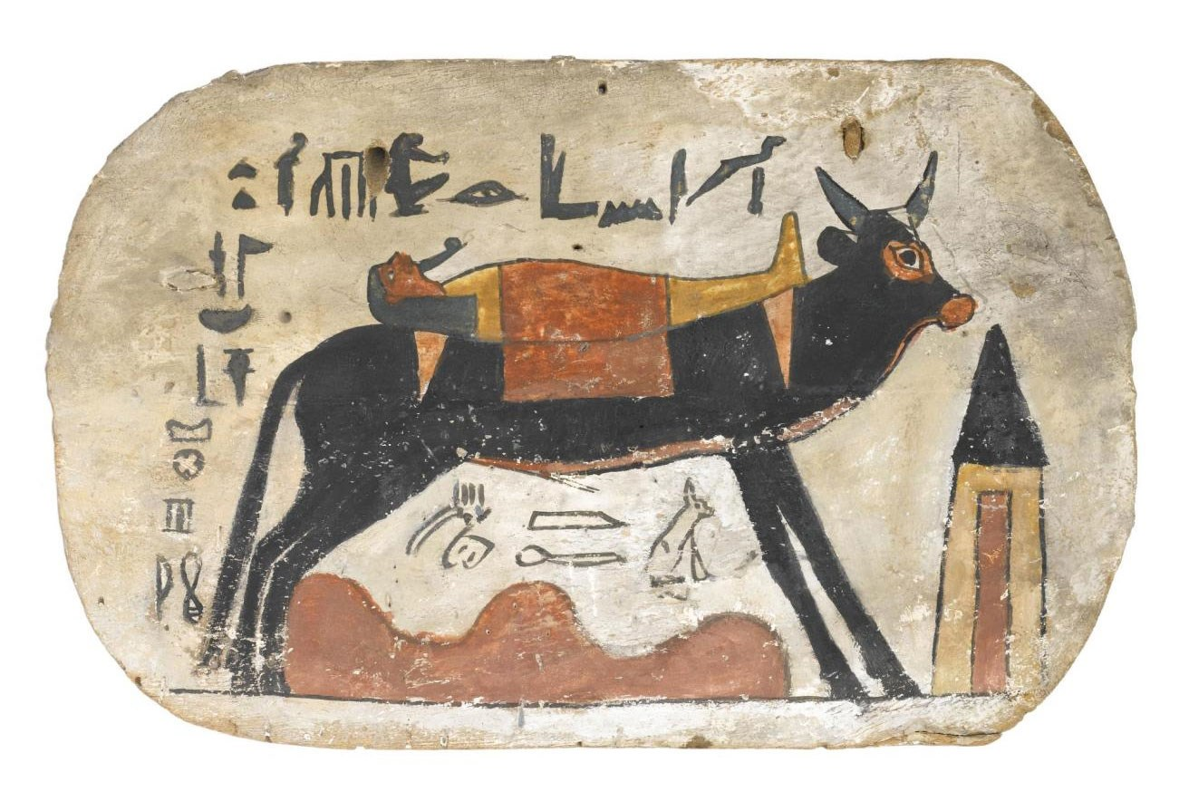 Footboard of wood, from cartonnage coffin or mummy-case, depicting the Apis bull carrying the mummy of the deceased, named as Pamiu, striding over the desert towards a pyramidal tomb: Ancient Egyptian, from Thebes, Upper Egypt, 3rd Intermediate Period, 22nd Dynasty, Osorkon III, 790-762 BC.