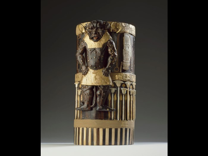 Box of cedar wood with ebony veneers and ivory inlays and gilding depicting the god Bes and bearing the cartouches of Amenhotep II: Ancient Egyptian, New Kingdom, 18th Dynasty, c.1550-1295 BC.