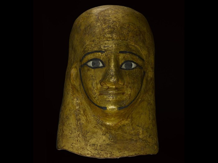 Mummy-mask of gilded and painted linen and plaster cartonnage, depicting Montsuef wearing a lappet-wig: Ancient Egyptian, excavated by A.H. Rhind in the tomb of Montsuef at Sheikh Abd el-Qurna, Thebes, Early Roman Period, c.9BC