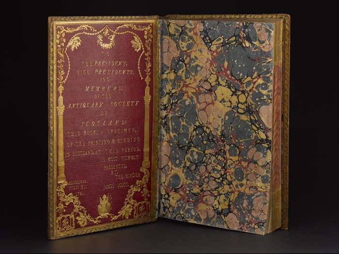 Front board with tooled inscription and marbled end paper of Paradise Lost by John Milton, bound by James Scott, 1781.