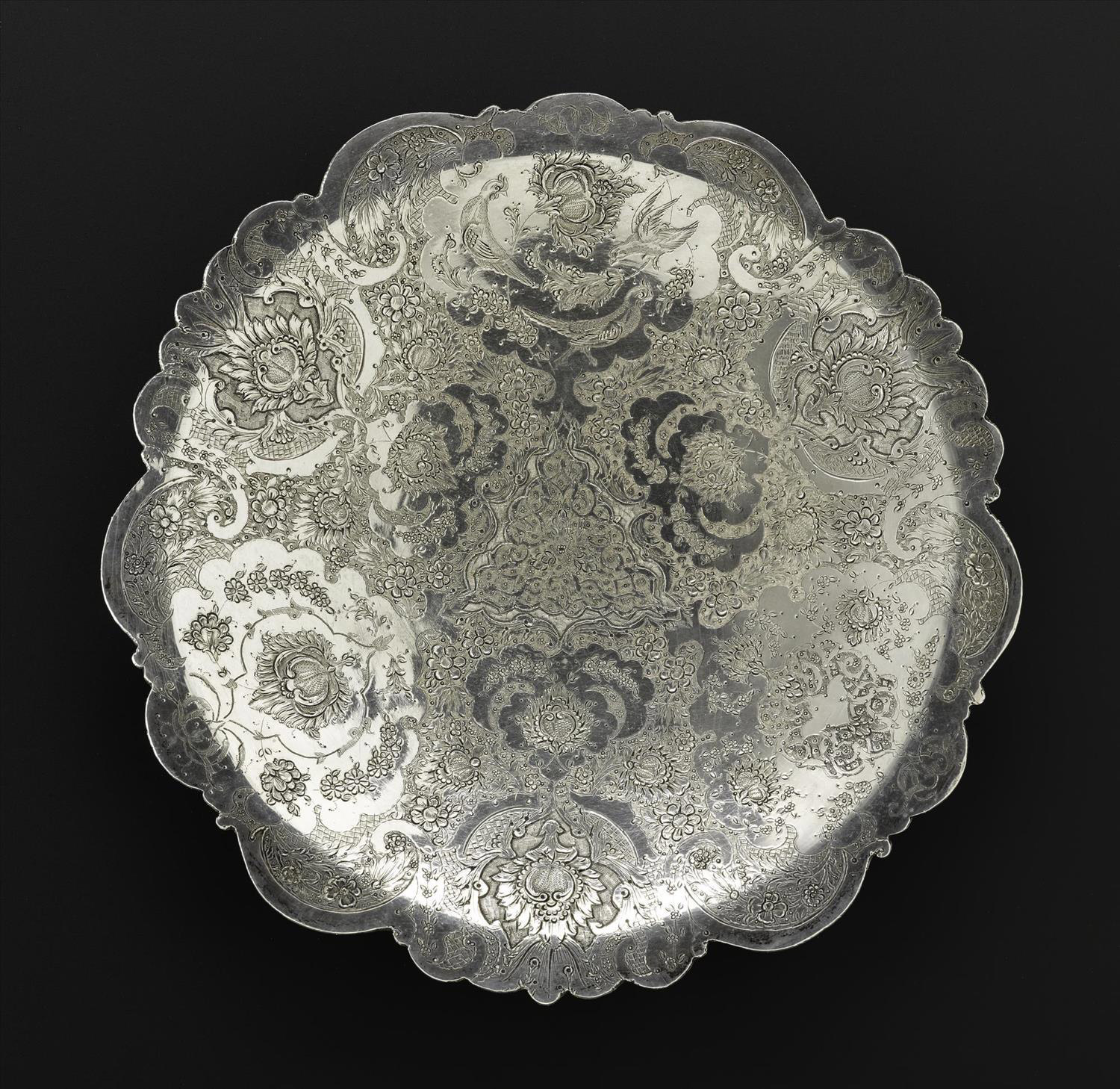 Circular dish of silver, shallow, engraved with floral decoration and three birds depicted in profile in the top centre medallion, hallmarked on the reverse, Iran, probably Isfahan, 1920s-1940s, acc.no V.2015.61