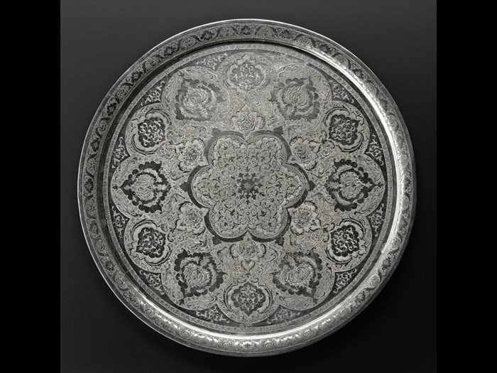 Circular tray of silver with a chased pattern of stylized floral motifs and animals, hallmarked on the front, Iran, probably Isfahan, 1920s-1940s, acc. no V.2015.62