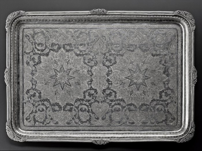 Rectangular tray of silver with a symmetrical pattern of two star shapes surrounded by stylized floral motifs and animals, hallmarked on the front, Iran, probably Isfahan, 1920s-1940s, acc. no V.2015.63