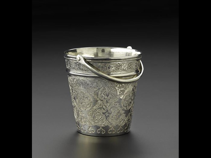 Miniature ice bucket of silver, with a handle and floral decoration around the outside, Iran, probably Isfahan, 1920s-1940s, acc. no V.2015.67