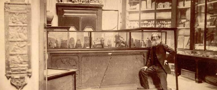 Joseph Anderson, Keeper of the Museum of Antiquities , with its displays in the Royal Institution, c.1890.
