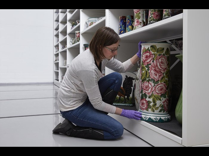 Adrienne, Assistant Curator of Scottish History and Archaeology selects Umbrella Stand from storage in the National Museums Collection Centre. The Cabbage roses on this late 19th century piece are one of the most recognisable Wemyss Ware designs.