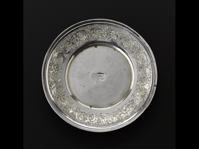 Miniature saucer of silver with floral decoration around the outside rim and hallmarked in the centre, part of a set with a cup and a spoon, Iran, probably Isfahan, 1920s-1940s, acc. no V.2015.68.2