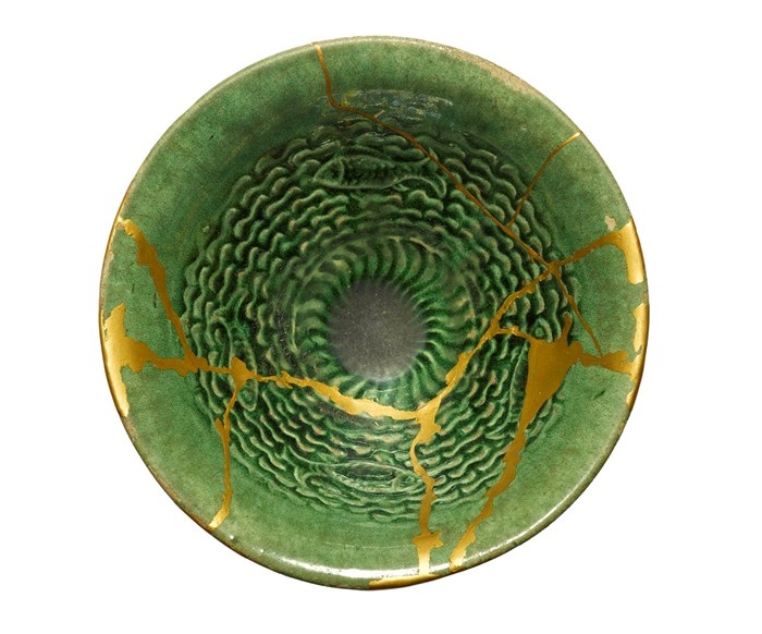 Cream white pottery bowl with kintsugi repair, China, Tang dynasty, 618-907 AD