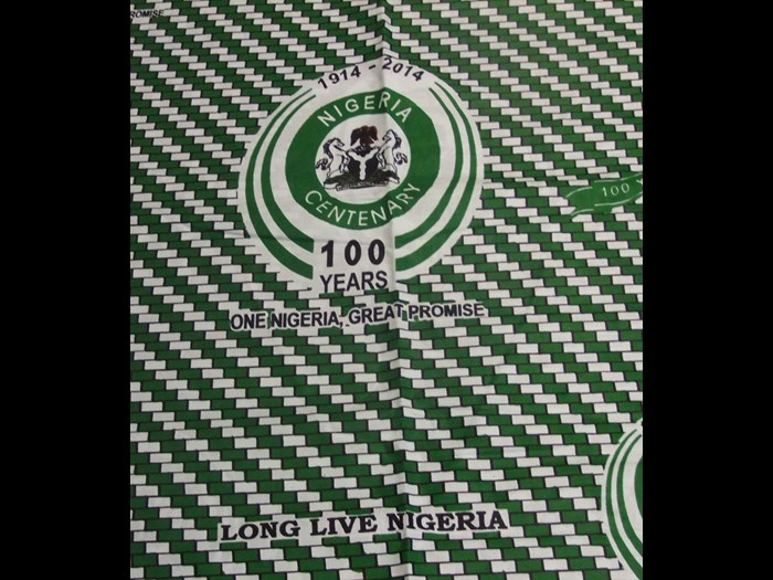 Cotton cloth printed to commemorate 'Nigeria100', marking the centenary of the merger between Northern and Southern Nigeria: Africa, West Africa, Nigeria, 2014.