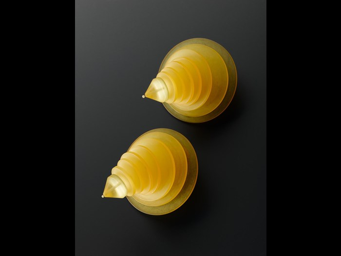 Clip-on earrings of translucent yellow acrylic: British, designed for Jean Muir by C & N Buttons & Jewellery Production, 1980s.