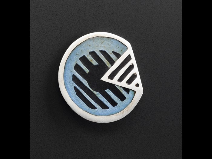 Button of silver, with enamel inlay: British, by Iain Young for Jean Muir Ltd, 1966-95.