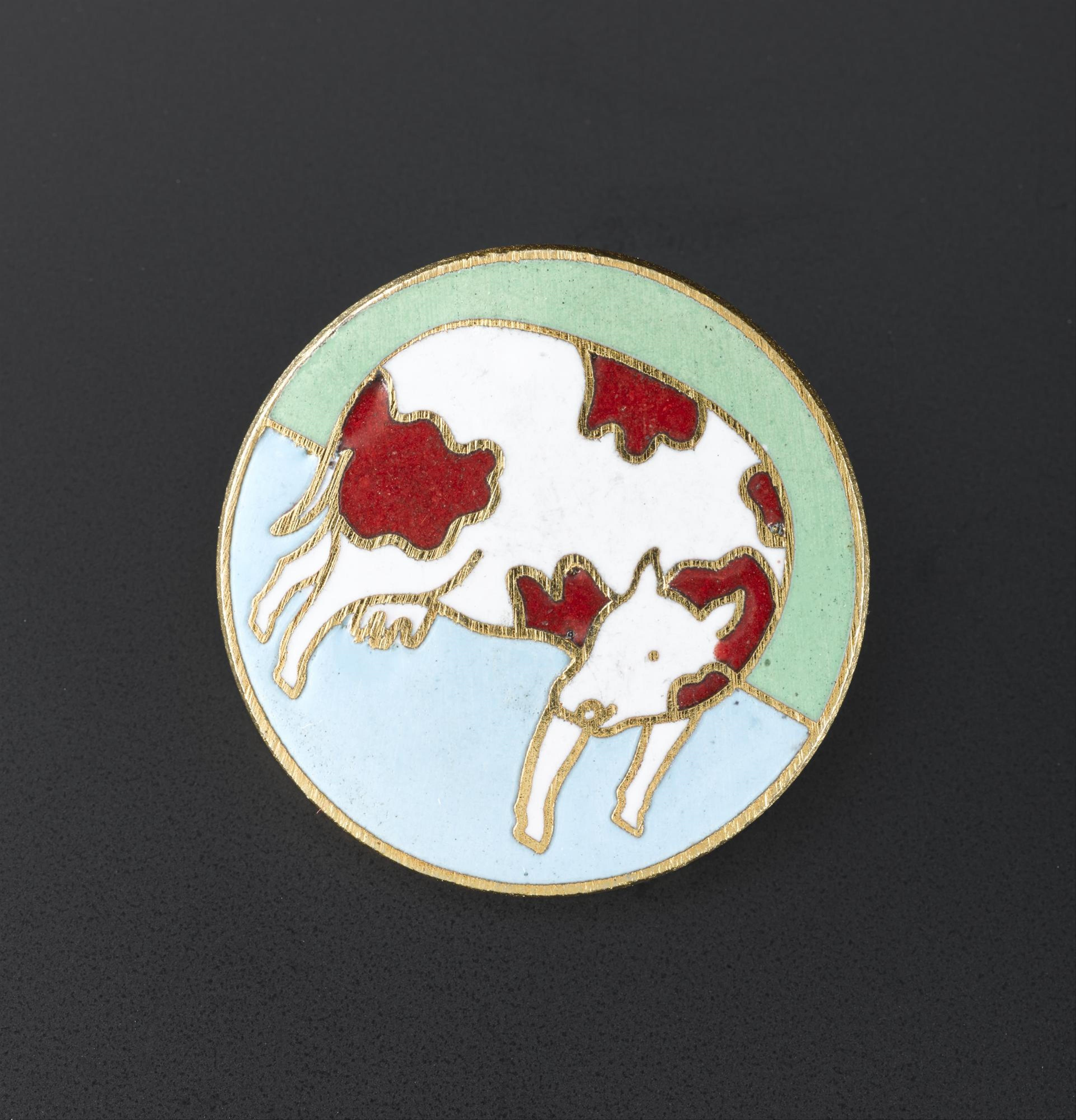 Button featuring a cow motif in enamel, possibly on silver gilt: British, by Marks of Distinction for Jean Muir Ltd, c.1972.