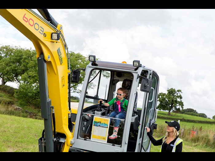 Testing skills on a real digger in 2016 © Ruth Armstrong Photography.