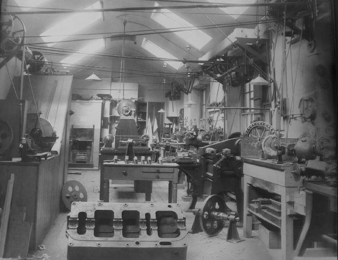 The roof top workshop c.1926. Models in the picture include a model water filter and the hull of a ship.