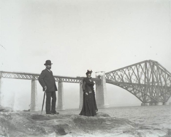 Couple posing in front of the Forth Bridge, 1905