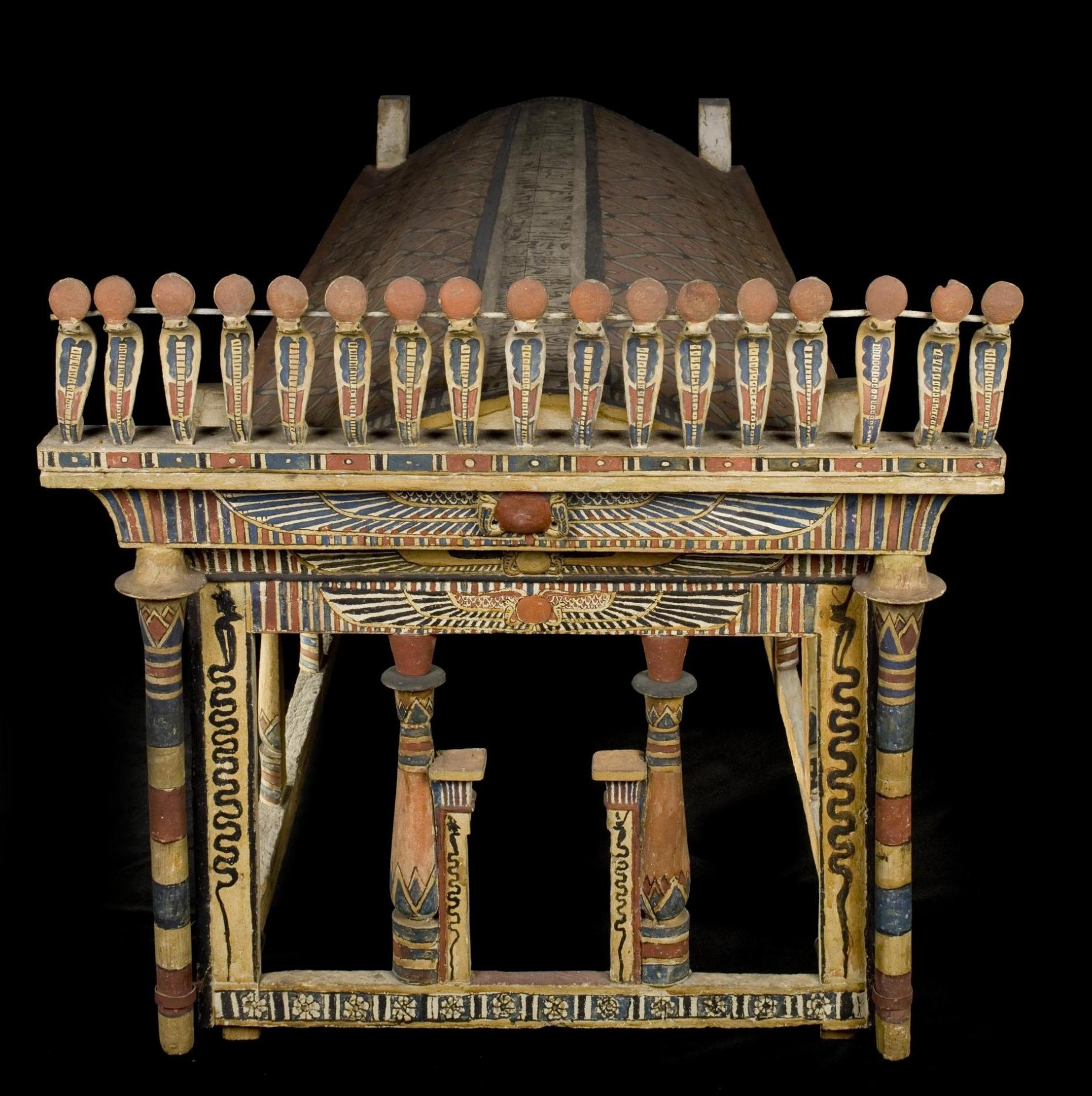 Canopy of sycamore-fig wood painted in red, black, blue, yellow and white in the shape of a shrine, with an arched roof and corner-posts : Ancient Egyptian, excavated at Sheikh Abd el-Qurna, Thebes, c.9BC.