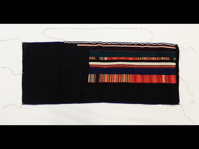 Woman's black cotton bodice decorated with striped cotton applique with borders of white beads, worn under jackets: Asia, South East Asia, North Thailand, Chiangrai, Lawle or Amphur Maechan, Akha people, by Mina, 1984.