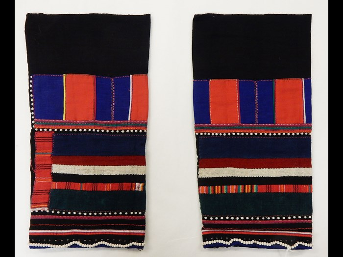 Woman's black cotton leggings decorated with panels and stripes in cotton applique with white beads: Asia, South East Asia, North Thailand, Chiangrai, Lawle or Amphur Maechan, Akha people, by Mina, 1984.