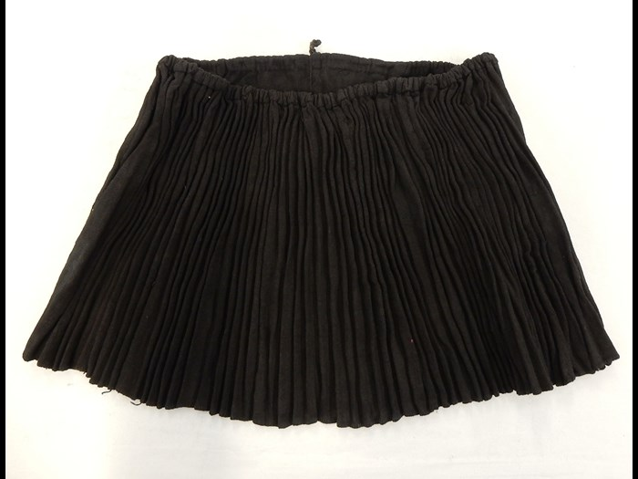 Woman's black cotton pleated skirt: Asia, South East Asia, North Thailand, worn in Chiangrai, Lawle or Amphur Maechan, Akha people, 1984.