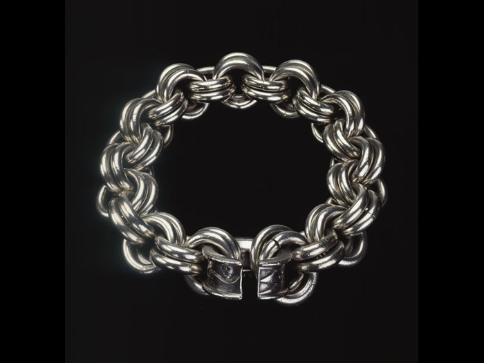 Massive silver chain, made from pairs of solid links and fastened with a penannular clasp decorated with Pictish symbols, from Parkhill, Aberdeenshire, AD 400–600.