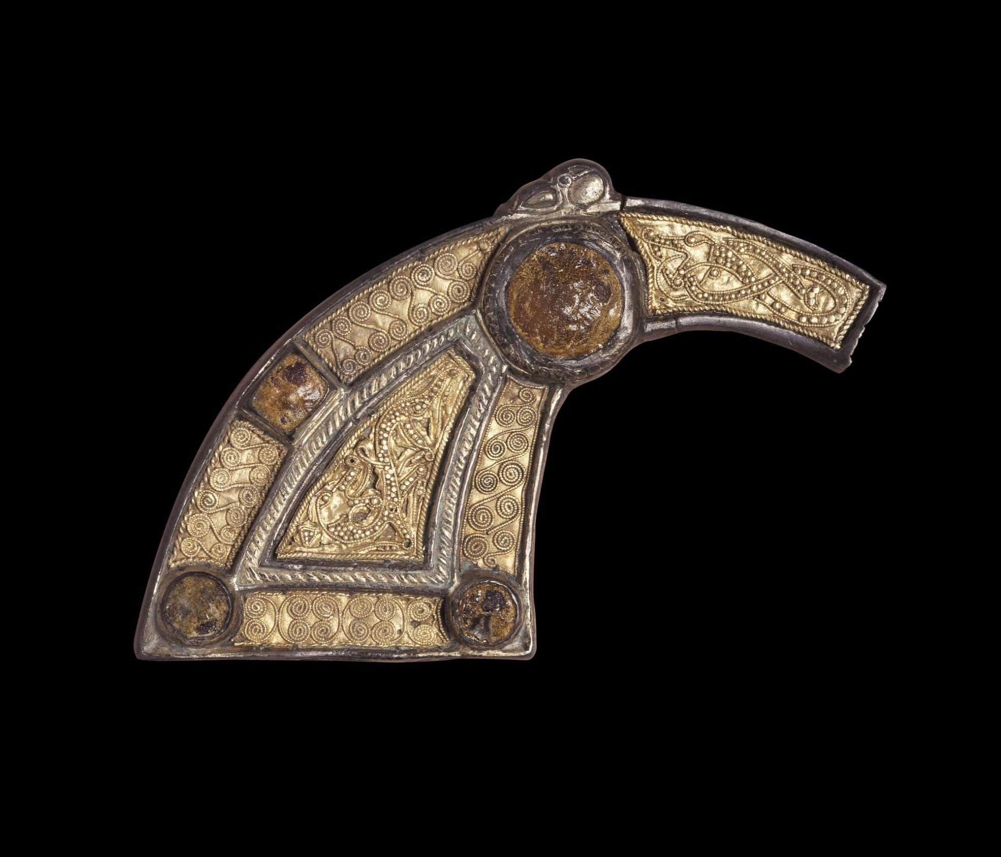 Portion of a silver pennanular brooch, ornamented with gold filigree and amber settings, from Dunbeath, Caithness, AD 650–750.