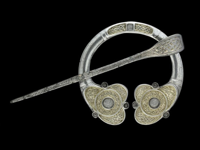 Silver pennanular brooch with gilded interlaced ornamentation, from Rogart, Sutherland, AD 700–800.