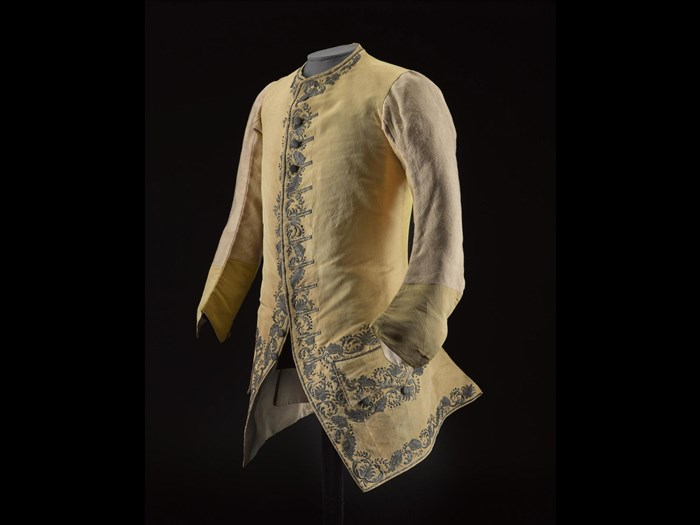 Man's sleeved waistcoat of yellow silk rep, embroidered with a floral design in silver thread, said to have belonged to Prince Charles Edward Stuart.