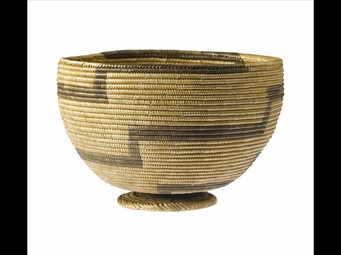 Basket-bowl of plaited grass figured with stepped bands in black: Africa, Southern Africa, Malawi or Zambia, late 19th century.