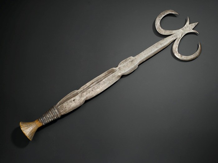 Ceremonial knife of iron with double pronged curved head and wooden handle bound with iron fillet: Africa, Central Africa, Democratic Republic of the Congo, Ngombe, early 20th century.