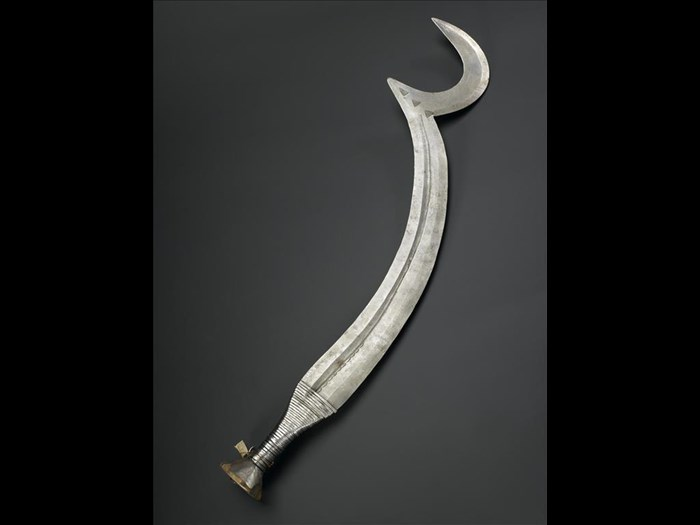 Beheadal knife of iron with crescentic point and handle of wood bound with iron fillet: Africa, Central Africa, Democratic Republic of the Congo, Ngombe, early 20th century.