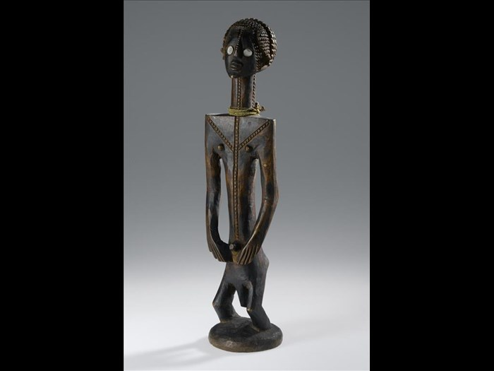 Carved wooden male figure with elongated body, hands on hips, bent knees, elaborate hair style, facial and body scarification decoration and shell eyes: Africa, Central Africa, Democratic Republic of the Congo, Katanga Province, Tabwa people, late 19th century.