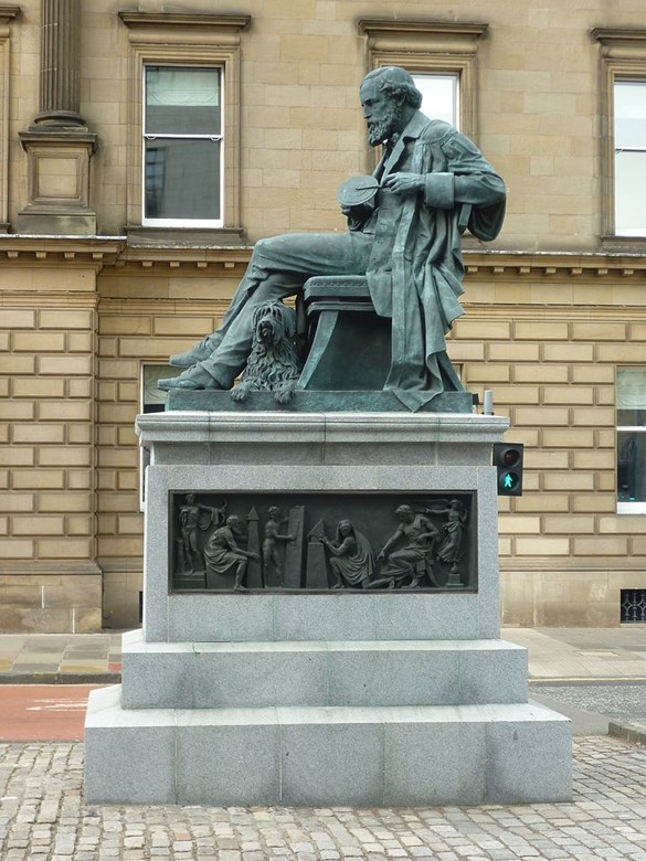 Statue of James Clerk Maxwell shown holding his colour top, erected in 2008 on George Street in Edinburgh.