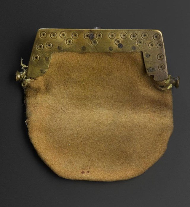 Small purse of deerskin with a rectangular brass clasp incised with dot-and-circle ornament, said to have been owned by Rob Roy MacGregor. Perthshire, 18th century.