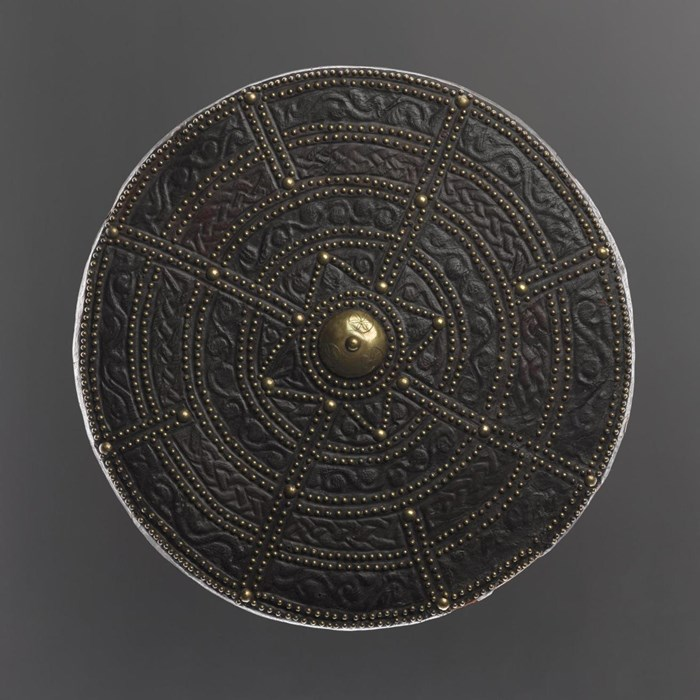 This leather targe is also reputed to have been acquired by Sir John Hynde Cotton, as an accoutrement for his tartan suit, during his visit to Scotland in 1744.