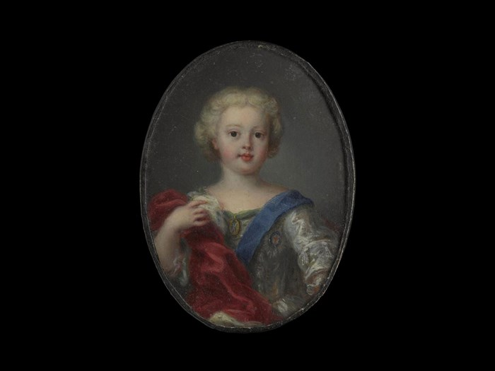 Miniature of Prince Charles Edward Stuart, at around three years old. Portrait miniatures painted in oil on copper plates of the exiled Stuart family, were popular with Jacobite supporters. These were versions of  portraits by the leading court painters.