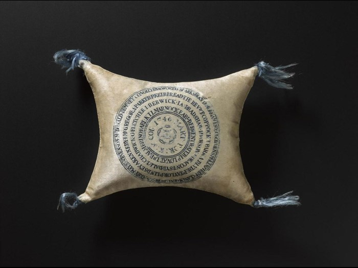"This pin cushion has 67 names are printed on it along with the words ""MART: FOR:K:&COU:1746"", meaning martyred for king and country 1746."