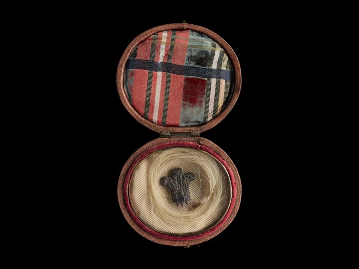 Locks of hair were a commonly found on such 'relics' purporting to be from the prince. This small locket contains hair alleged to have been that of Prince Charles Edward Stuart, with Prince of Wales feathers in the centre.