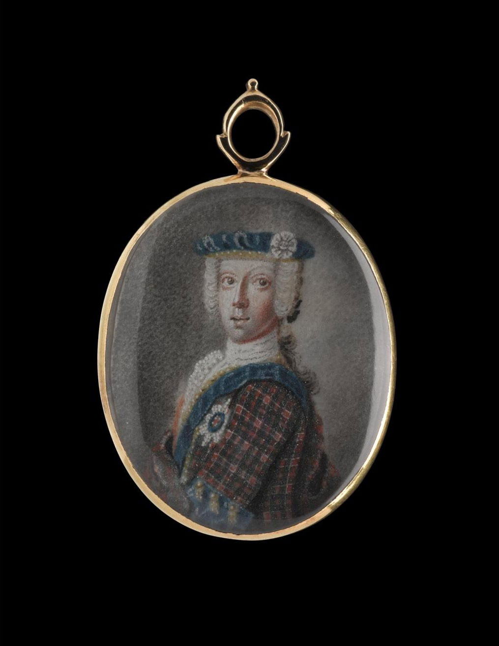 Four pieces of the prince's hair are attached to the reverse of this gold locket.