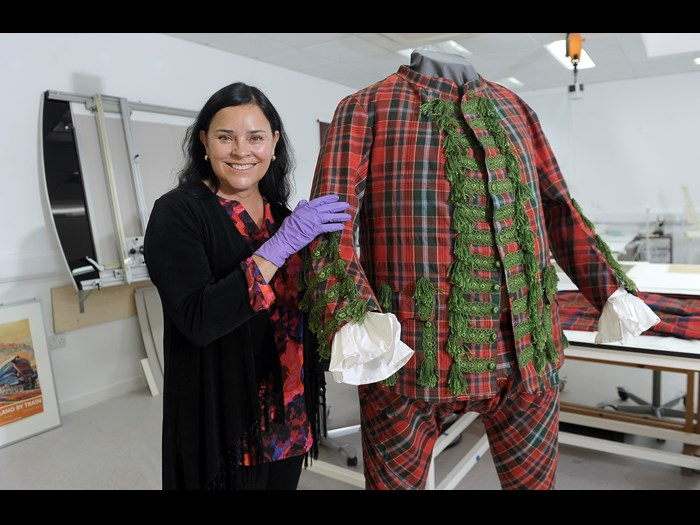 Diana Gabaldon with a tartan suit that belonged to English Jacobite Sir John Hynde Cotton.