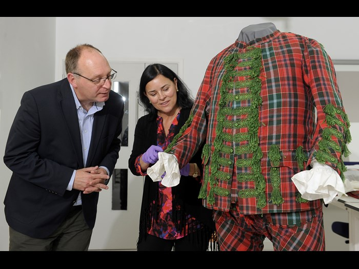 Diana Gabaldon and Principal Curator David Forsyth investigate a tartan suit bound for the Bonnie Prince Charlie and the Jacobites exhibition.