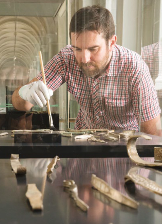 Martin Goldberg examining items from the Galloway Hoard