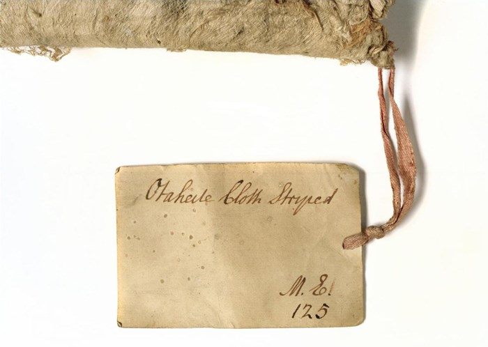Old label attached to A.UC.442 written by Professor John Walker, Keeper of the University Museum from 1779 to 1803, showing the original number in the University Collection; through this label the barkcloth can be linked to the voyages of Captain Cook