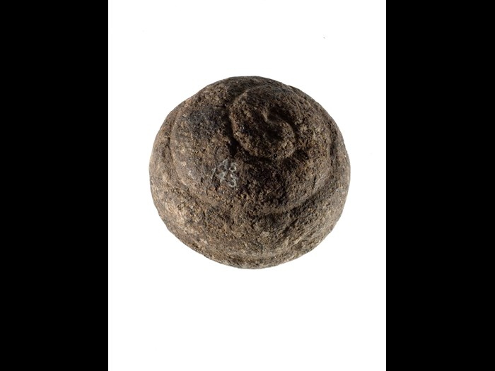 Carved stone ball with spiral ornament, from Buchan, Aberdeenshire, around 3000 BC.
