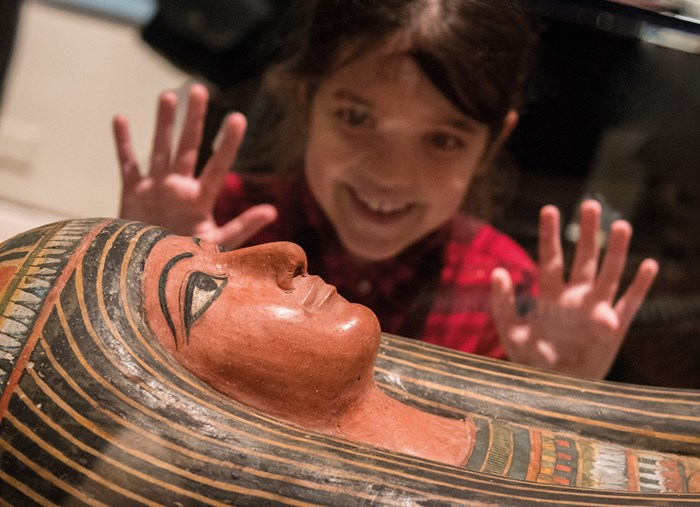 A young visitor enjoys The Tomb exhibition. Over 100,000 visits made it the most popular exhibition to date at the National Museum of Scotland.