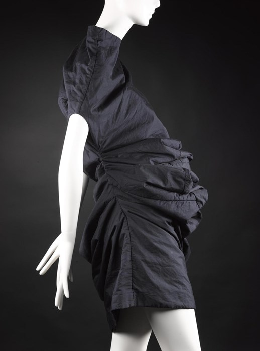 Dress from 'Body Meets Dress' or 'Bump' collection, of blue/black polyester and cotton, padded with tulle, designed by Rei Kawakubo for Comme des Garçons, Spring/Summer 1997. ©  Rei Kawakubo / Comme des Garcons.